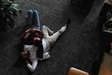Couple sleeping on floor in living room