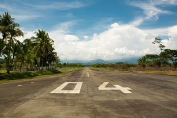 Local airport of Quepos in Costa Rica with the mountains and the forest