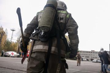 Firefighter holding fire axe a dangerous situation