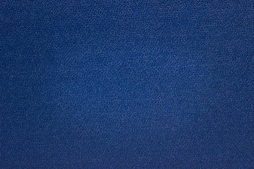 blue cardboard texture with non-smooth surface close-up