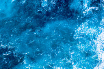 Crystal blue ocean waves aerial view background texture