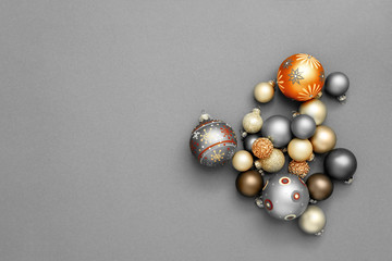 Christmas decoration glass balls on gray background