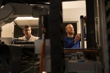 Robotic engineers working in warehouse