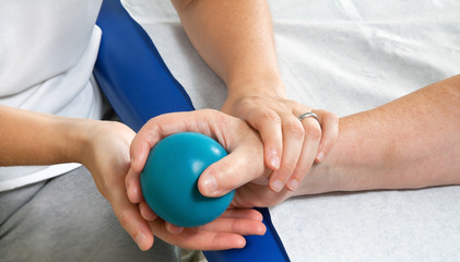 Hand with exercises blue ball