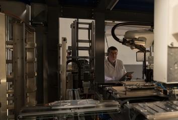 Robotic engineer working in warehouse