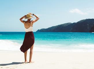 Woman relaxing on a tropical island enjoying the beach