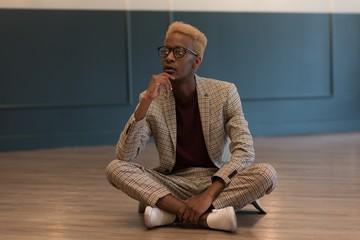 Businessman sitting on floor in office