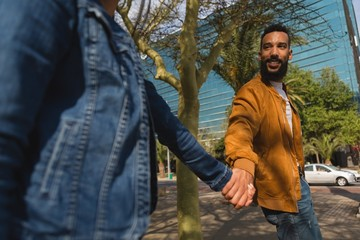 Couple holding hand in city street