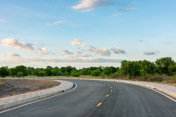 Empty asphalt road curve and clean blue sky in summer day background with copy space