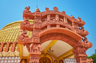 The stunning architecture of the temple of Sitagu International Buddhist Academy with terracotta torana gate, decorated with carved details, Sagaing, Myanmar.