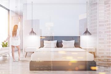 White master bedroom interior, woman