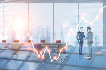 Businessmen in meeting room, graph