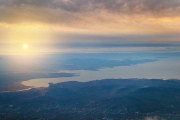 view from the plane to the island of Sakhalin, the mountains and the sea with the seaport