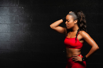 Young African American Fitness Woman Wearing Red
