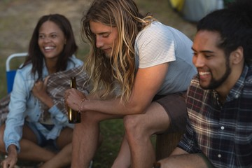 Group of friends having fun at campsite