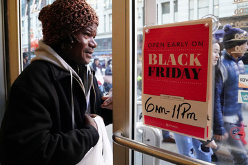A man walks out of a Payless shoe store during Black Friday shopping in New York City