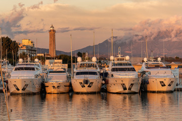 Estepona port in Spain at sunset under a dramatic sky.