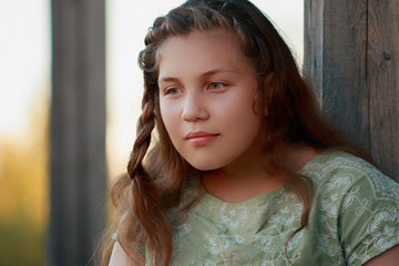 thoughtful young girl looking through the eyes to the bottom