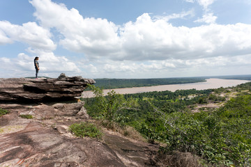 Thailand, Ubon Ratchathani Province, Pha Taem National Park, Woman looking to Mekong river, border to Laos