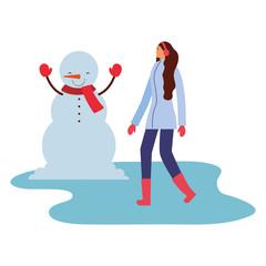 woman with snowman winter season