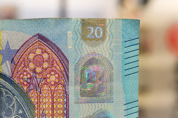 closeup of new banknote of twenty euros. out of focus in the background.