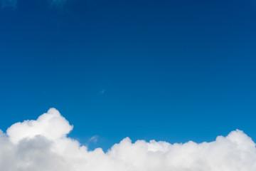 Blue sky with cloud on bottom