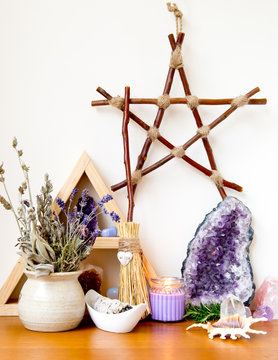 Witch's Altar with crystals, sage smudge stick, branch pentagram, mini broom with word 'witch' in silver heart