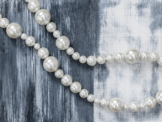 Pearl necklace on gray artistic background