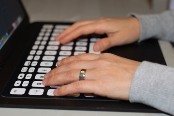 hands typing on the laptop's keyboard