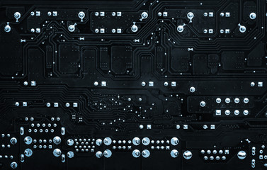 Abstract technical background from back side of motherboard. Toned image.