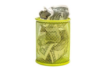 Crumpled dollar bills in trash bin. Isolated on white.