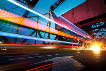 Fotomurales - abstract image of blur motion of cars on the city road at night,Modern urban architecture in tianjin, China