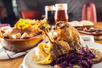 Roasted christmas duck leg red cabbage dumplings liver draft beer and baked buns