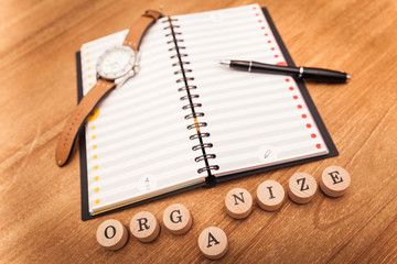 time management for life and business, diary and pen