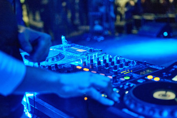 Dj hands mixing track outdoor at party festival nightlife view of disco club outside