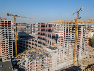 Aerial view of construction site with cranes