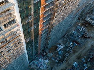 Aerial top view of building facade under construction