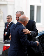 Russia's Foreign Minister Sergei Lavrov is welcomed by Portuguese Foreign Minister Augusto Santos Silva at Necessidades palace in Lisbon