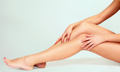 Beautiful female legs and hands, Skin care concept. Laser hair removal