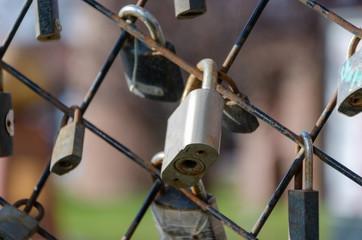 Lot of padlocks hanging on the railings