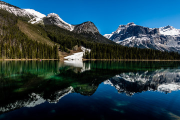 Last traces of snow reach into Emerald Lake, Yoho National Park, British Columbia, Canada