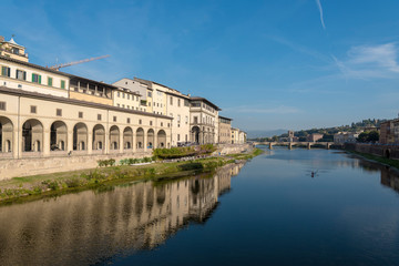 View of the Arno river in Florence, Tuscany, Italy, from Ponte Vecchio. Bridge at a distance of Ponte alle Grazie.