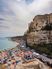 Wall Mural - Panorama of Tropea, Italy and the crowded beach of bathers.