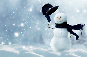 Wall Mural - Merry christmas and happy new year greeting card with copy-space.Happy snowman standing in winter christmas landscape.Snow background