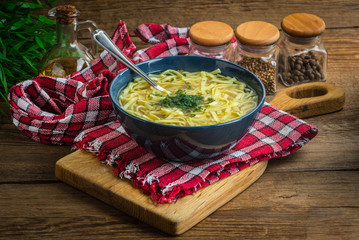 Broth - chicken soup in a bowl.