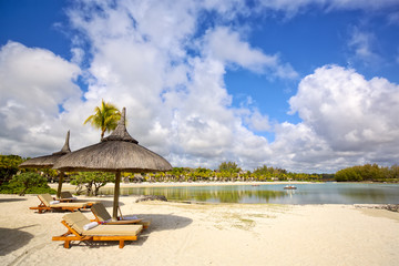 Wall Mural - Sand beach with lounge chairs and umbrellas in Mauritius Island