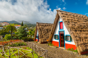 Traditional historic thatched houses with strawy roofs on Madeira island, Santana, Portugal Fototapete