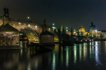 View of the Charles Bridge and Vltava river in Prague in a cold winter night - 1
