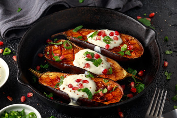Cooked eggplants with yogurt sauce and pomegranate seeds, pars