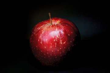 Red fresh apple with on black background